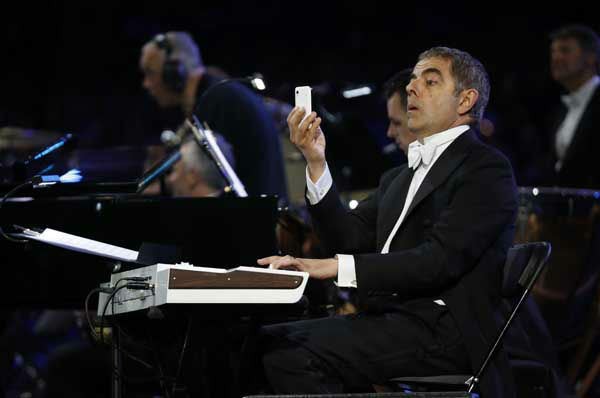 Actor Rowan Atkinson performs during the Opening Ceremony at the 2012 Summer Olympics, Friday, July 27, 2012, in London. &#40;AP Photo&#47;Matt Dunham&#41; <span class=meta>(AP Photo&#47; Matt Dunham)</span>