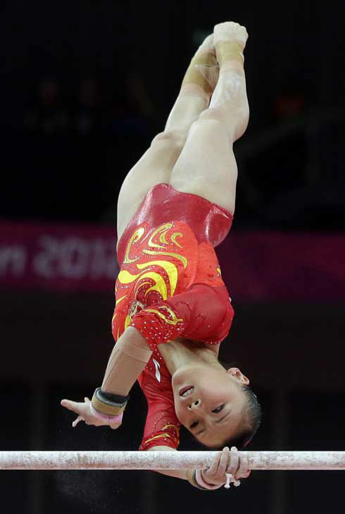 Chinese gymnast He Kexin performs on the uneven bars during the Artistic Gymnastics women&#39;s team final at the 2012 Summer Olympics, Tuesday, July 31, 2012, in London. &#40;AP Photo&#47;Julie Jacobson&#41; <span class=meta>(AP Photo&#47; Julie Jacobson)</span>