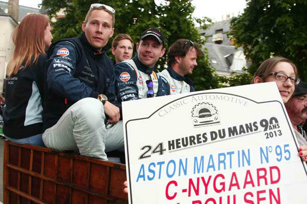 FILE - Danish Driver Allan Simonsen, left, is seen during a parade on the eve of the 90th 24-hour Le Mans endurance race, in Le Mans, western France, in this Friday, June 21, 2013 photo. The No.95 Aston Martin Vantage GTE, driven by Simonsen, exited the track at high speed at the &#34;Tertre Rouge&#34; corner on his fourth lap of the race, He died after due to his injuries,  Saturday, June 22, 2013.&#40;AP Photo&#47;Michel Spingler, File&#41; <span class=meta>(AP Photo&#47; Michel Spingler)</span>