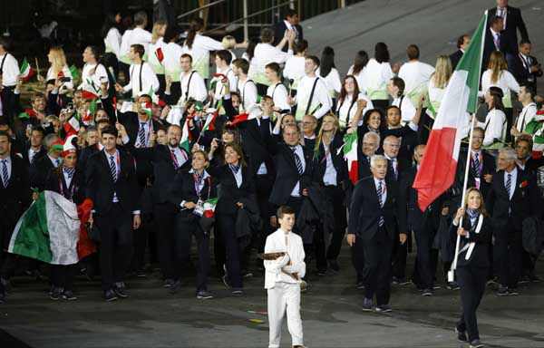 Italy&#39;s Valentina Vezzali carries the flag during the Opening Ceremony at the 2012 Summer Olympics, Friday, July 27, 2012, in London. &#40;AP Photo&#47;Jae C. Hong&#41; <span class=meta>(AP Photo&#47; Jae C. Hong)</span>