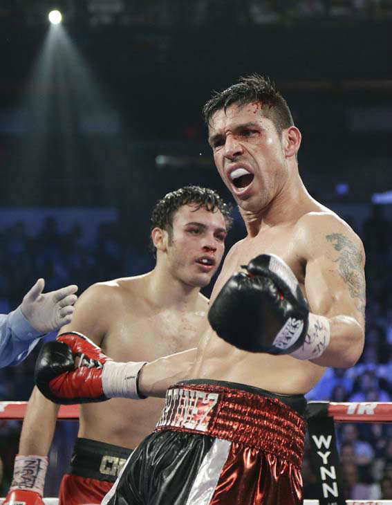 Sergio Martinez, right, reacts as the bell rings to end the 10th round against Julio Cesar Chavez Jr. during the WBC middleweight title fight, Saturday, Sept. 15, 2012, in Las Vegas. Martinez won by unanimous decision. &#40;AP Photo&#47;Julie Jacobson&#41; <span class=meta>(AP Photo&#47; Julie Jacobson)</span>