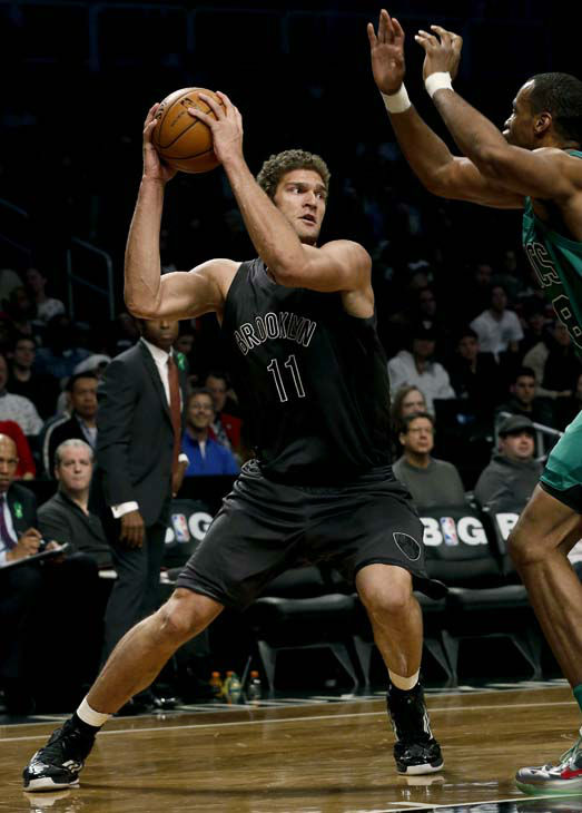 Brooklyn Nets center Brook Lopez &#40;11&#41; looks to pass against Boston Celtics center Jason Collins &#40;98&#41; in the first half of their NBA basketball game at Barclays Center, Tuesday, Dec. 25, 2012, in New York. Boston won 93-76. &#40;AP Photo&#47;John Minchillo&#41; <span class=meta>(AP Photo&#47; John Minchillo)</span>
