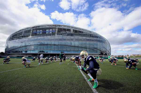 Notre Dame Fooball player&#39;s practice during a training session at the Aviva Stadium, Dublin, Ireland, Thursday, Aug. 30, 2012.  American colledge football team Notre Dame play the Navy team on Saturday in Dublin.  &#40;AP Photo&#47;Peter Morrison&#41; <span class=meta>(AP Photo&#47; Peter Morrison)</span>