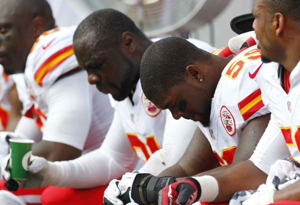 Kansas City Chiefs&#39; Tamba Hali &#40;91&#41; and Jovan Belcher &#40;59&#41; sit on the bench during their loss to the Buffalo Bills in an NFL football game in Orchard Park, N.Y., Sunday, Sept. 16, 2012. &#40;AP Photo&#47;Bill Wippert&#41; <span class=meta>(AP Photo&#47; Bill Wippert)</span>