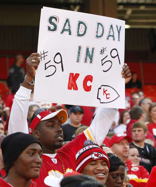 A Kansas City Chiefs fan holds a sign during the first half of an NFL football game against the Carolina Panthers at Arrowhead Stadium in Kansas City, Mo., Sunday, Dec. 2, 2012. The Chiefs&#39; ended an eight-game losing streak with a 27-21 victory over the Panthers just a day after their linebacker Jovan Belcher shot his girlfriend multiple times at a residence near the stadium. He then drove to the team&#39;s practice facility and turned the gun on himself as general manager Scott Pioli and coach Romeo Crennel looked on. &#40;AP Photo&#47;Colin E. Braley&#41; <span class=meta>(AP Photo&#47; Colin E. Braley)</span>