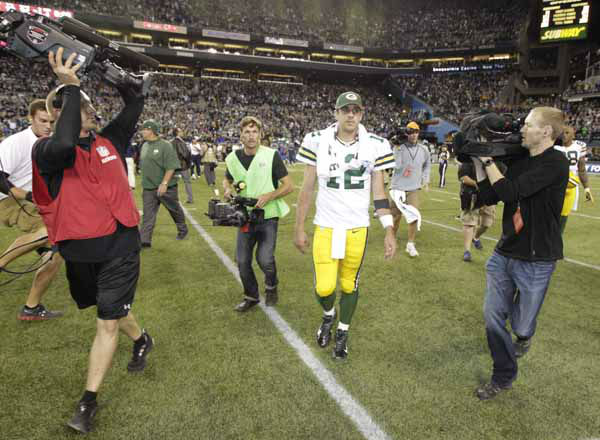 "<div class=""meta ""><span class=""caption-text "">Green Bay Packers quarterback Aaron Rodgers starts to leave the field after the Seattle Seahawks score a last second touchdown in the second half of an NFL football game, Monday, Sept. 24, 2012, in Seattle. The Seahawks won 14-12. (AP Photo/Ted S. Warren) (AP Photo/ Ted S. Warren)</span></div>"