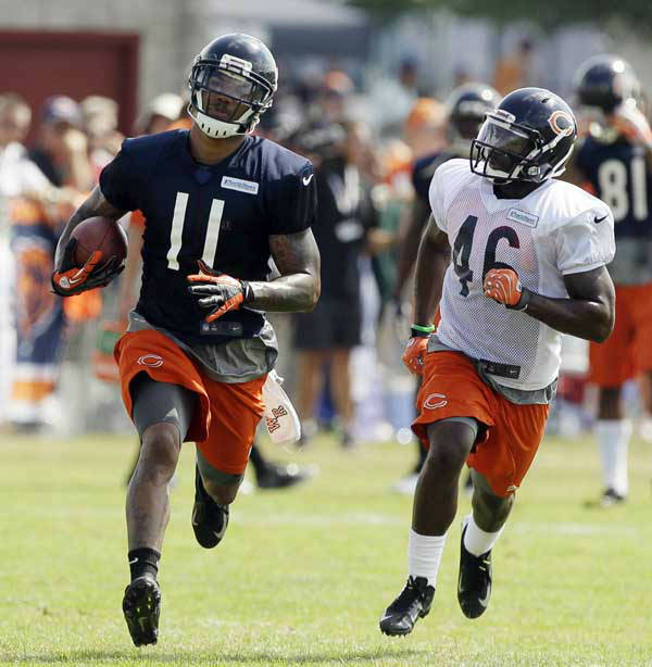 Chicago Bears wide receiver Devin Thomas &#40;11&#41; runs with a ball past safety Jeremy Jones &#40;46&#41; during NFL football training camp at Olivet Nazarene University in Bourbonnais, Ill., Thursday, July 26, 2012. &#40;AP Photo&#47;Nam Y. Huh&#41; <span class=meta>(AP Photo&#47; Nam Y. Huh)</span>