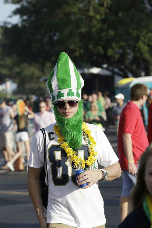 "<div class=""meta ""><span class=""caption-text "">Ron Bokon walks near the stadium before the BCS National Championship college football game between Alabama and Notre Dame Monday, Jan. 7, 2013, in Miami.(AP Photo/David J. Phillip) (AP Photo/ David J. Phillip)</span></div>"
