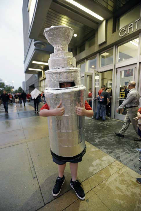 A fan dressed as Stanley Cup arrives at the United Center for Game 1 of the NHL Stanley Cup Final hockey series between the Chicago Blackhawks and the Boston Bruins, Wednesday, June 12, 2013, in Chicago. &#40;AP Photo&#47;Nam Y. Huh&#41; <span class=meta>(AP Photo&#47; Nam Y. Huh)</span>