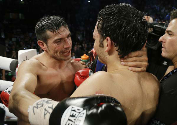 Sergio Martinez, right, talks with Julio Cesar Chavez Jr. at the end of their WBC middleweight title fight, Saturday, Sept. 15, 2012, in Las Vegas. Martinez won by unanimous decision. &#40;AP Photo&#47;Julie Jacobson&#41; <span class=meta>(AP Photo&#47; Julie Jacobson)</span>