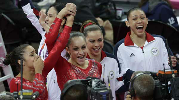 "<div class=""meta image-caption""><div class=""origin-logo origin-image ""><span></span></div><span class=""caption-text"">U.S. gymnasts, from left to right, Alexandra Raisman, Jordyn Wieber, McKayla Maroney and Kyla Ross celebrate after being declared winners of the gold medal during the Artistic Gymnastic women's team final at the 2012 Summer Olympics, Tuesday, July 31, 2012, in London. (AP Photo/Gregory Bull) (AP Photo/ Gregory Bull)</span></div>"