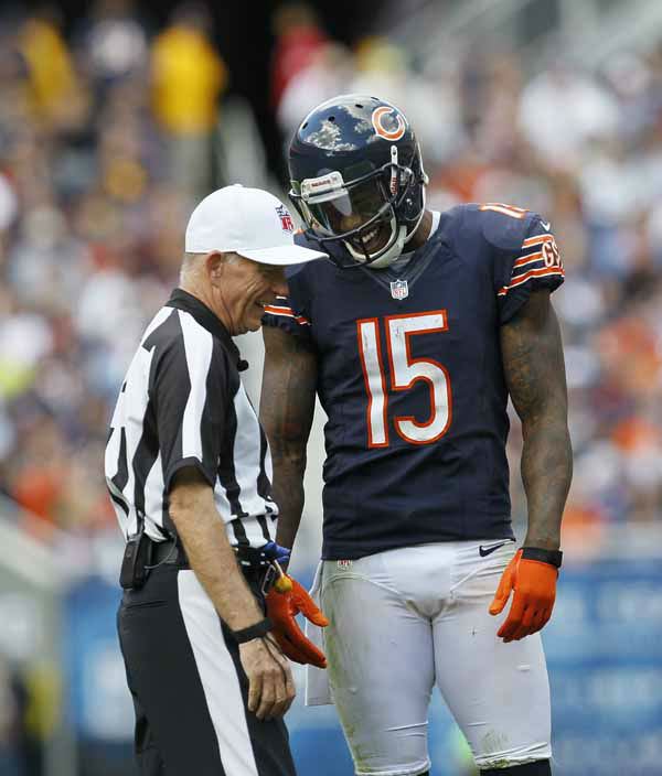 "<div class=""meta image-caption""><div class=""origin-logo origin-image ""><span></span></div><span class=""caption-text"">Chicago Bears wide receiver Brandon Marshall (15) laughs as he talks to head linesman George Hayward (54) in the second half of an NFL football game in Chicago, Sunday, Sept. 23, 2012. (AP Photo/Charles Rex Arbogast) (AP Photo/ Charles Rex Arbogast)</span></div>"