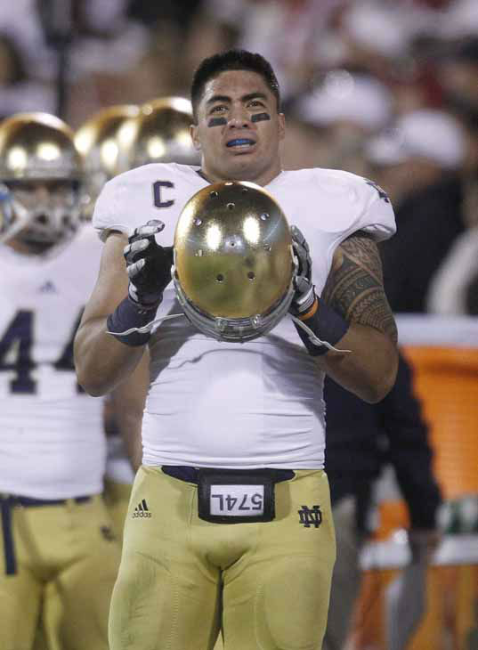 "<div class=""meta image-caption""><div class=""origin-logo origin-image ""><span></span></div><span class=""caption-text"">Notre Dame linebacker Manti Te'o on the sidelines of an NCAA college football game against Oklahoma in Norman, Okla., Saturday, Oct. 27, 2012. (AP Photo/Sue Ogrocki) (Photo/Sue Ogrocki)</span></div>"