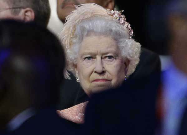 "<div class=""meta ""><span class=""caption-text "">Queen Elizabeth II attends the Opening Ceremony at the 2012 Summer Olympics, Friday, July 27, 2012, in London. (AP Photo/David Goldman) (AP Photo/ David Goldman)</span></div>"