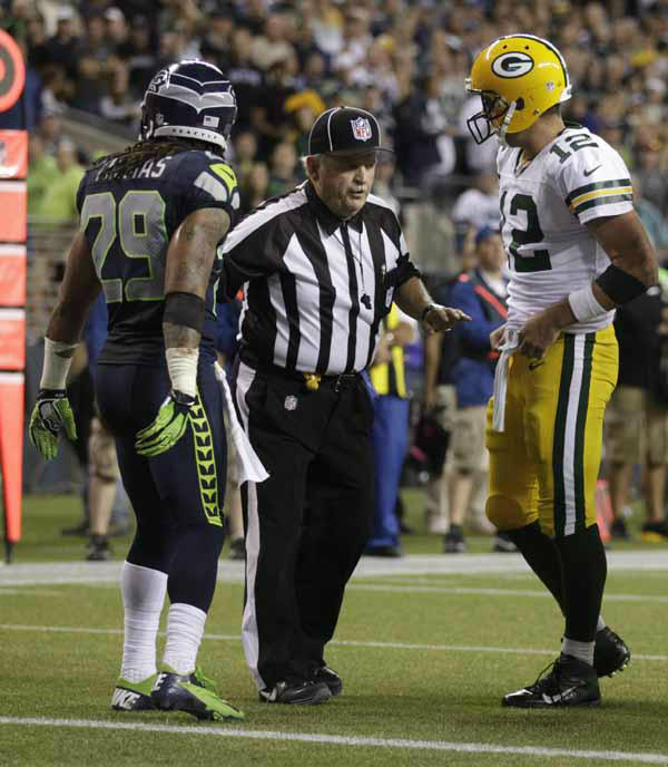 Seattle Seahawks Earl Thomas and Green Bay Packers Aaron Rodgers listen to an official during the second half of an NFL football game, Monday, Sept. 24, 2012, in Seattle. &#40;AP Photo&#47;Stephen Brashear&#41; <span class=meta>(AP Photo&#47; Stephen Brashear)</span>
