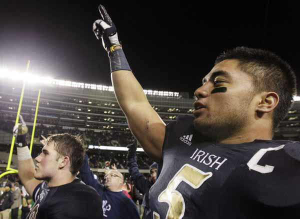 Notre Dame linebacker Manti Te&#39;o &#40;5&#41; celebrates with teammates after they defeated Miami 41-3 in an NCAA college football game in Chicago, Saturday, Oct. 6, 2012. &#40;AP Photo&#47;Nam Y. Huh&#41; <span class=meta>(AP Photo&#47; Nam Y. Huh)</span>