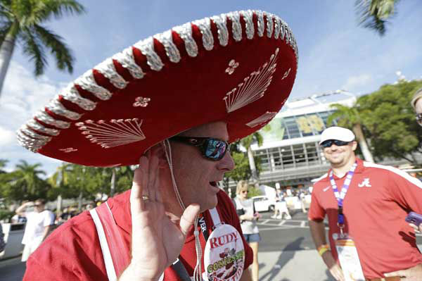 Brian Dawes walks near the stadium before the BCS National Championship college football game between Alabama and Notre Dame Monday, Jan. 7, 2013, in Miami. &#40;AP Photo&#47;David J. Phillip&#41; <span class=meta>(AP Photo&#47; David J. Phillip)</span>