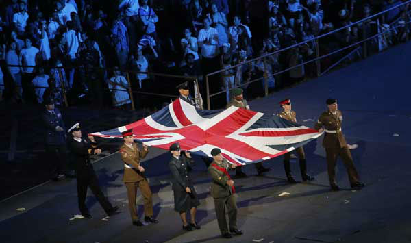 Performers march with the flag of Great Britain during the Opening Ceremony at the 2012 Summer Olympics, Friday, July 27, 2012, in London. &#40;AP Photo&#47;Christophe Ena&#41; <span class=meta>(AP Photo&#47; Christophe Ena)</span>