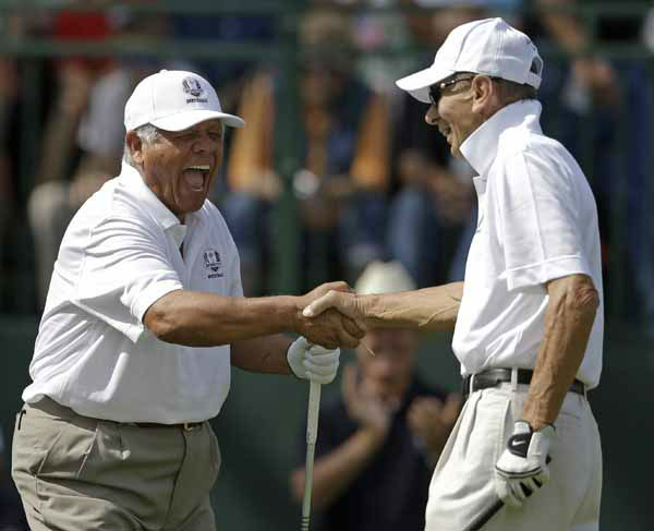 Lee Trevino, left, shakes hands with Stan Mikita during a celebrity scramble event at the Ryder Cup PGA golf tournament Tuesday, Sept. 25, 2012, at the Medinah Country Club in Medinah, Ill. &#40;AP Photo&#47;Chris Carlson&#41; <span class=meta>(AP Photo&#47; Chris Carlson)</span>