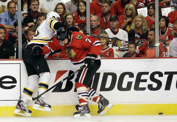 Boston Bruins left wing Daniel Paille &#40;20&#41; and Chicago Blackhawks defenseman Brent Seabrook &#40;7&#41; collide during the first period of Game 1 in their NHL Stanley Cup Final hockey series on Wednesday, June 12, 2013, in Chicago. &#40;AP Photo&#47;Nam Y. Huh&#41; <span class=meta>(AP Photo&#47; Nam Y. Huh)</span>