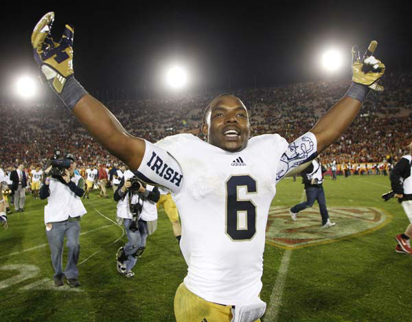 Notre Dame running back Theo Riddick celebrates after Notre Dame defeated Southern California 22-13 in an NCAA college football game, Saturday, Nov. 24, 2012, in Los Angeles. &#40;AP Photo&#47;Danny Moloshok&#41; <span class=meta>(AP Photo&#47; Danny Moloshok)</span>