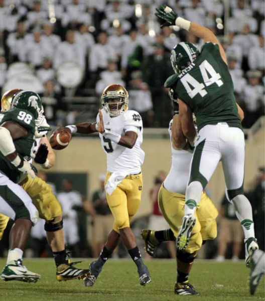 Notre Dame quarterback Everett Golson, center, looks to pass between Michigan State&#39;s Marcus Rush &#40;44&#41; and Anthony Rashad White &#40;98&#41; during the first quarter of an NCAA college football game, Saturday, Sept. 15, 2012, in East Lansing, Mich. &#40;AP Photo&#47;Al Goldis&#41; <span class=meta>(AP Photo&#47; Al Goldis)</span>