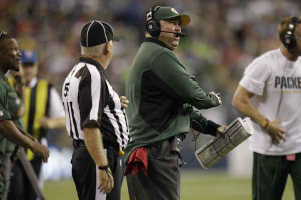 Green Bay Packers head coach Mike McCarthy, second from right, talks with an official during the NFL football game against the Seattle Seahawks, Monday, Sept. 24, 2012, in Seattle. &#40;AP Photo&#47;Ted S. Warren&#41; <span class=meta>(AP Photo&#47; Ted S. Warren)</span>