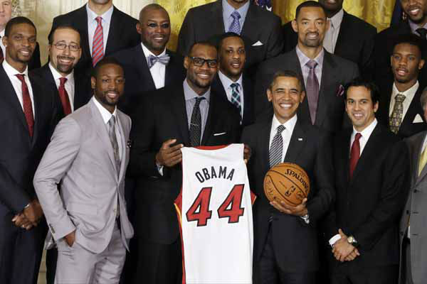 President Barack Obama stands with LeBron James, fifth from left, Dwayne Wade, third left, and coach Erik Spoelstra, right, as he honors the NBA champions Miami Heat basketball team in the East Room at the White House in Washington, Monday, Jan. 28, 2013. &#40;AP Photo&#47;Charles Dharapak&#41; <span class=meta>(Photo&#47;Charles Dharapak)</span>
