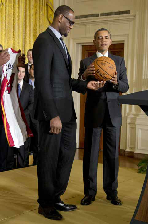 "<div class=""meta ""><span class=""caption-text "">President Barack Obama accepts a signed basketball from Miami Heat forward LeBron James as he welcomes the the NBA basketball champion Miami Heat, to the East Room of the White House, Monday, Jan. 28, 2013, in Washington. (AP Photo/Carolyn Kaster) (AP Photo/ Carolyn Kaster)</span></div>"