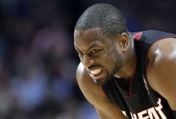 Miami Heat guard Dwyane Wade reacts as he watches a free throw by Chicago Bulls forward Luol Deng during the second half of an NBA basketball game in Chicago on Wednesday, March 27, 2013. The Bulls won 101-97, ending the Heat&#39;s 27-game winning streak. &#40;AP Photo&#47;Nam Y. Huh&#41; <span class=meta>(AP Photo&#47; Nam Y. Huh)</span>
