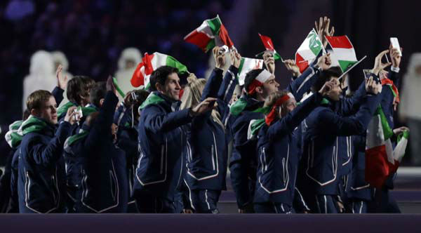 Members of the Italian team cheer as they enter the stadium during the opening ceremony of the 2014 Winter Olympics in Sochi, Russia, Friday, Feb. 7, 2014. &#40;AP Photo&#47;Patrick Semansky&#41; <span class=meta>(Photo&#47;Patrick Semansky)</span>