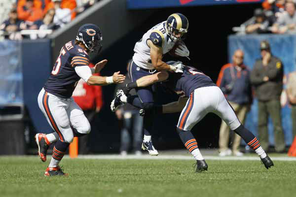 St. Louis Rams wide receiver Danny Amendola &#40;16&#41; leaps in the air as he is tackled by Chicago Bears long snapper Patrick Mannelly &#40;65&#41; and Chicago Bears strong safety Craig Steltz &#40;20&#41;in the second half of an NFL football game in Chicago, Sunday, Sept. 23, 2012. &#40;AP Photo&#47;Charles Rex Arbogast&#41; <span class=meta>(AP Photo&#47; Charles Rex Arbogast)</span>