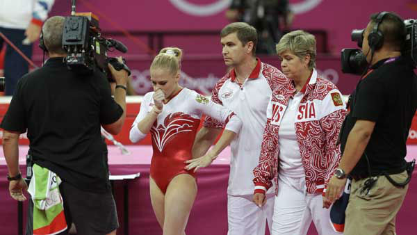 Russian gymnast Kseniia Afanaseva walks dejected after falling during her floor exercise during the Artistic Gymnastics women&#39;s team final at the 2012 Summer Olympics, Tuesday, July 31, 2012, in London. &#40;AP Photo&#47;Julie Jacobson&#41; <span class=meta>(AP Photo&#47; Julie Jacobson)</span>
