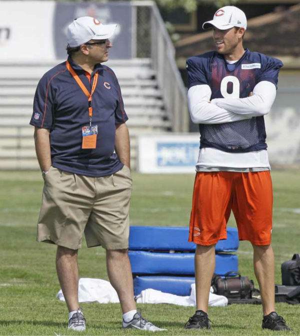 Chicago Bears president Ted Phillips, left, talks with kicker Robbie Gould during NFL football training camp at Olivet Nazarene University in Bourbonnais, Ill., Thursday, July 26, 2012. &#40;AP Photo&#47;Nam Y. Huh&#41; <span class=meta>(AP Photo&#47; Nam Y. Huh)</span>