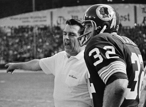 Defense-minded Washington Redskins&#39; coach George Allen is shown conferring with his defensive leader linebacker Jack Pardee during a recent game. Allen leads the NFC champion Skins against the Miami Dolphins, AFC champion team, in the super bowl in Los Angeles, Jan. 6, 1973. &#40;AP Photo&#41; <span class=meta>(AP Photo&#47; XJFM R3  RE.)</span>