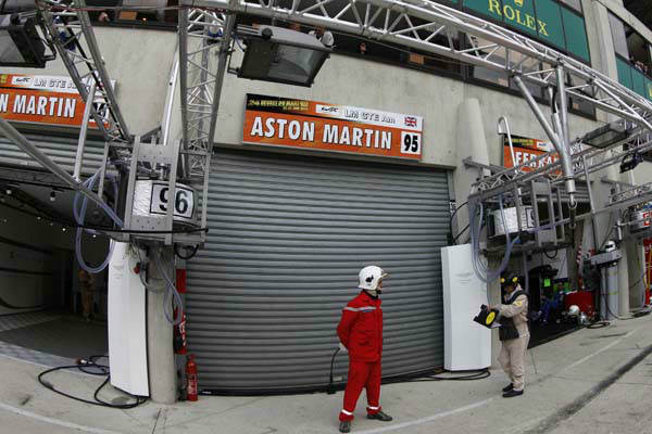 The garage of the No.95 Aston Martin Vantage GTE, driven by  Allan Simonsen of Denmerk is shuttered after his crash   Saturday, June 22, 2013. The Aston Martin Vantage , driven by Simonsen, exited the track at high speed at the &#34;Tertre Rouge&#34; corner on his fourth lap of the race. He died later due to his injuries.&#40;AP Photo&#41; <span class=meta>(AP Photo&#47; MS JW**LON**)</span>