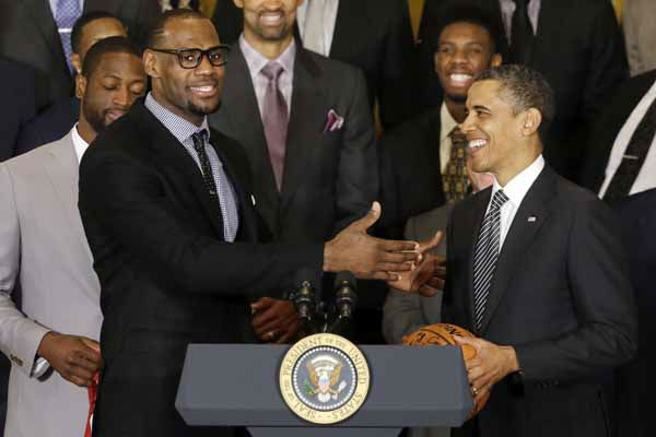 LeBron James speaks after presenting President Barack Obama with a basketball signed by the NBA champions Miami Heat basketball team in the East Room at the White House in Washington, Monday, Jan. 28, 2013. &#40;AP Photo&#47;Charles Dharapak&#41; <span class=meta>(AP Photo&#47; Charles Dharapak)</span>