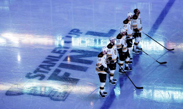 Boston Bruins players line up during the national anthem before Game 1 in their NHL Stanley Cup Final hockey series against the Chicago Blackhawks,Wednesday, June 12, 2013 in Chicago. &#40;AP Photo&#47;Charles Rex Arbogast&#41; <span class=meta>(AP Photo&#47; Charles Rex Arbogast)</span>