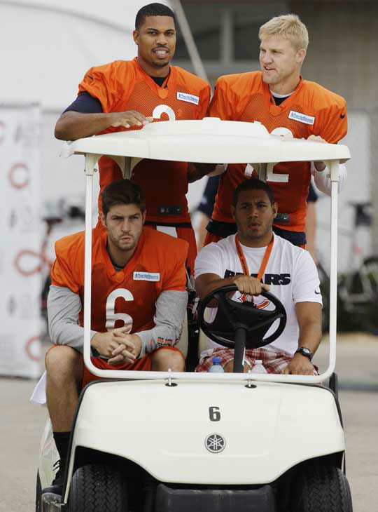 Chicago Bears quarterbacks Jay Cutler &#40;6&#41;, Jason Campbell &#40;2&#41; and Josh McCown &#40;12&#41; ride a golf cart during NFL football training camp at Olivet Nazarene University in Bourbonnais, Ill., Thursday, July 26, 2012. &#40;AP Photo&#47;Nam Y. Huh&#41; <span class=meta>(AP Photo&#47; Nam Y. Huh)</span>