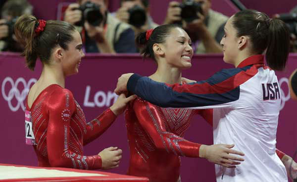 U.S. gymnast Kyla Ross, center, hugs teammate U.S. gymnast Jordyn Wieber during the Artistic Gymnastics women&#39;s team final at the 2012 Summer Olympics, Tuesday, July 31, 2012, in London. &#40;AP Photo&#47;Julie Jacobson&#41; <span class=meta>(AP Photo&#47; Julie Jacobson)</span>