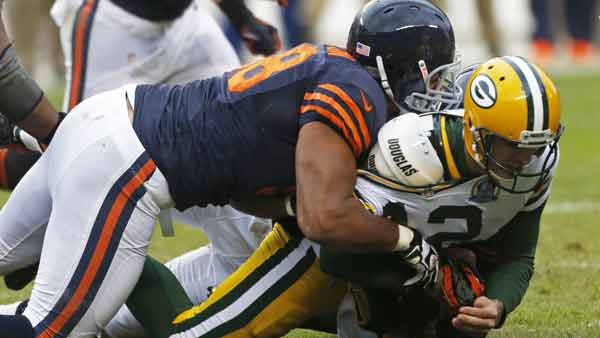 Green Bay Packers quarterback Aaron Rodgers (12) gets sacked by Chicago Bears defensive end Corey Wootton (98) in the first half of an NFL football game in Chicago, Sunday, Dec. 16, 2012. (AP Photo/Charles Rex Arbogast)