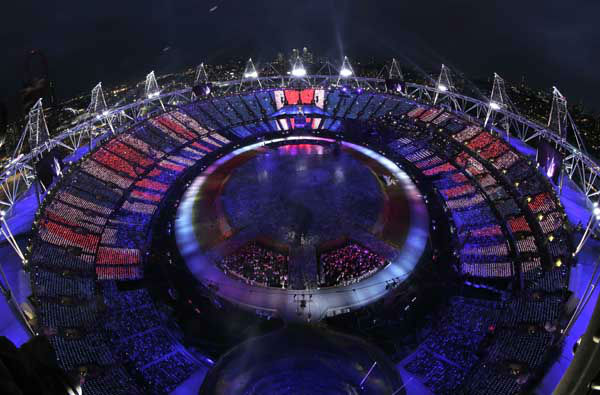 Audience members holding LED panels light up the stadium during the Opening Ceremony at the 2012 Summer Olympics, Friday, July 27, 2012, in London. &#40;AP Photo&#47;David J. Phillip&#41; <span class=meta>(AP Photo&#47; David J. Phillip)</span>