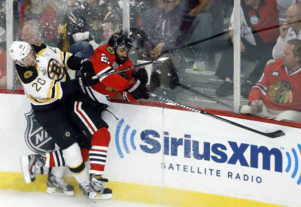 Boston Bruins left wing Daniel Paille &#40;20&#41; and Chicago Blackhawks defenseman Johnny Oduya &#40;27&#41; collide during the first period of Game 1 in their NHL Stanley Cup Final hockey series on Wednesday, June 12, 2013, in Chicago. &#40;AP Photo&#47;Charles Rex Arbogast&#41; <span class=meta>(AP Photo&#47; Charles Rex Arbogast)</span>