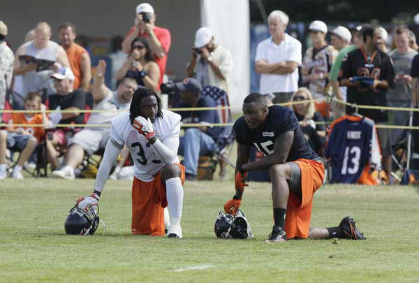 Chicago Bears cornerback Charles Tillman, left, and wide receiver Brandon Marshall &#40;15&#41;watch teammates practice during NFL football training camp at Olivet Nazarene University in Bourbonnais, Ill., Thursday, July 26, 2012. &#40;AP Photo&#47;Nam Y. Huh&#41; <span class=meta>(AP Photo&#47; Nam Y. Huh)</span>