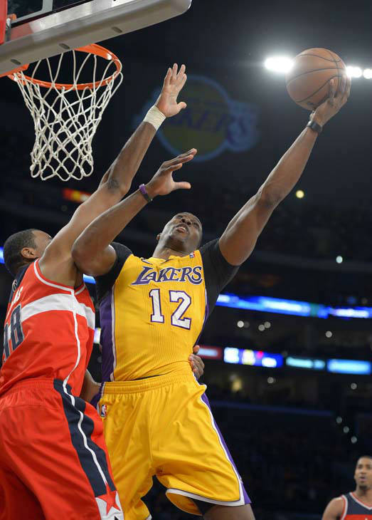 Los Angeles Lakers center Dwight Howard, right, puts up a shot as Washington Wizards center Jason Collins defends during the first half of an NBA basketball game, Friday, March 22, 2013, in Los Angeles. &#40;AP Photo&#47;Mark J. Terrill&#41; <span class=meta>(AP Photo&#47; Mark J. Terrill)</span>