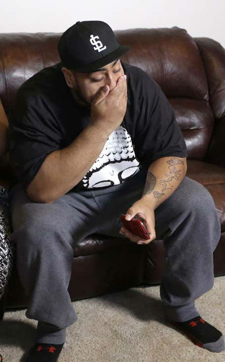 Star Lotulelei, from Utah, reacts after being selected 14th overall by the Carolina Panthers during an NFL football draft party at their home, Thursday, April 25, 2013, in South Jordan, Utah. &#40;AP Photo&#47;Rick Bowmer&#41; <span class=meta>(AP Photo&#47; Rick Bowmer)</span>