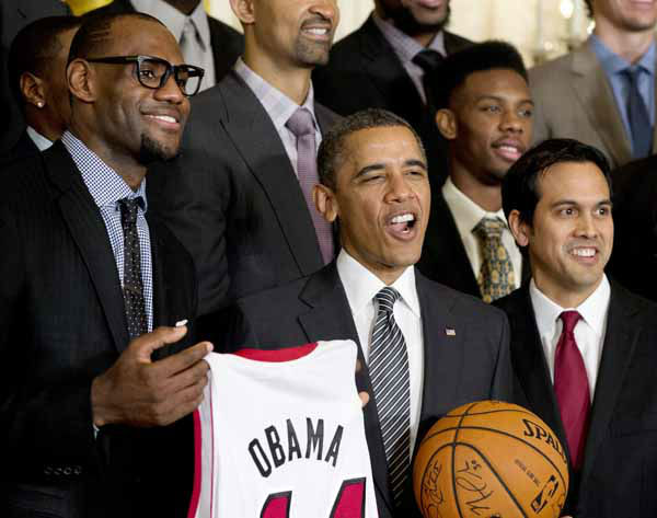 "<div class=""meta ""><span class=""caption-text "">President Barack Obama is flanked by Miami Heat forward LeBron James, left, and coach Erik Spoelstra, right, as he welcomes the NBA basketball champion Miami Heat, to the East Room of the White House, Monday, Jan. 28, 2013, in Washington. (AP Photo/Carolyn Kaster) (AP Photo/ Carolyn Kaster)</span></div>"