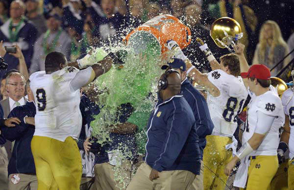 Notre Dame coach Brian Kelly receives a dousing as other team members celebrate after Notre Dame defeated Southern California 22-13 in an NCAA college football game, Saturday, Nov. 24, 2012, in Los Angeles. &#40;AP Photo&#47;Mark J. Terrill&#41; <span class=meta>(AP Photo&#47; Mark J. Terrill)</span>