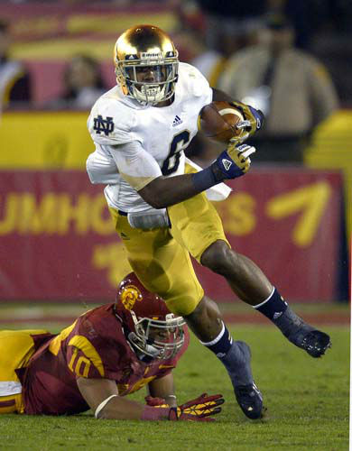 Notre Dame running back Theo Riddick, left, runs the ball as Southern California linebacker Hayes Pullard during the first half of their NCAA college football game, Saturday, Nov. 24, 2012, in Los Angeles. &#40;AP Photo&#47;Mark J. Terrill&#41; <span class=meta>(AP Photo&#47; Mark J. Terrill)</span>