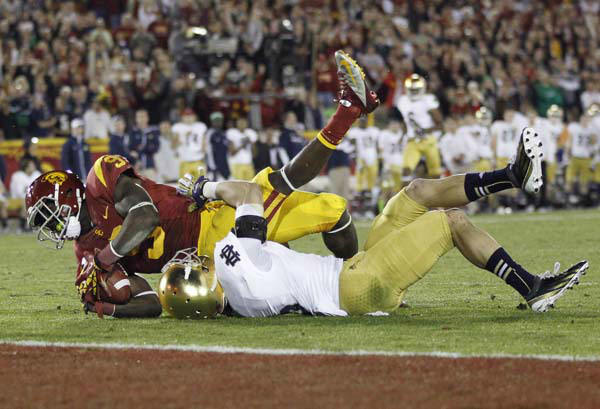 Southern California wide receiver Marqise Lee, left, is brought down short of the end zone by Notre Dame cornerback Bennett Jackson, right, after a large pass reception during the second half of their NCAA college football game, Saturday, Nov. 24, 2012, in Los Angeles. &#40;AP Photo&#47;Danny Moloshok&#41; <span class=meta>(AP Photo&#47; Danny Moloshok)</span>